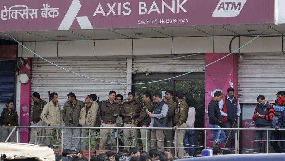 Policemen outside an Axis Bank branch in Noida.