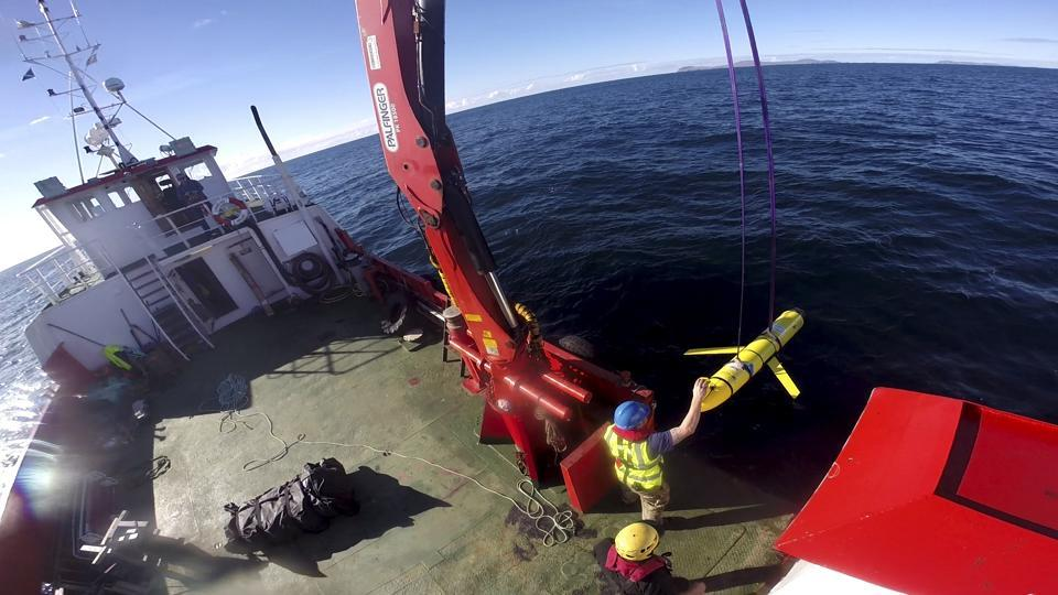 In a handout photo, an underwater drone is recovered off the coast of Scotland in October. The capture of the US underwater drone by Chinese Navy last week brought more diplomatic tensions to the surface.