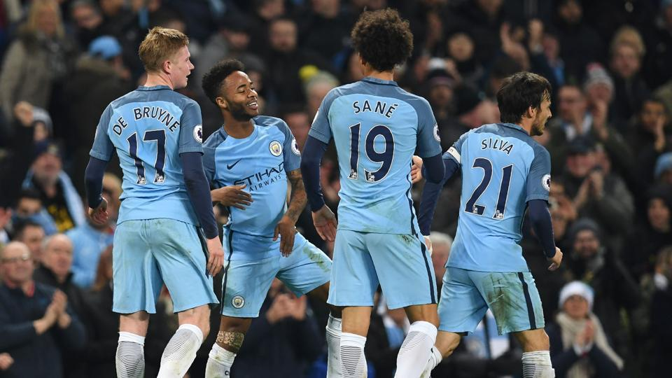 Manchester City's English midfielder Raheem Sterling (2nd L) celebrates with teammates after scoring their second goal during the English Premier League football match between Manchester City and Arsenal at the Etihad Stadium.