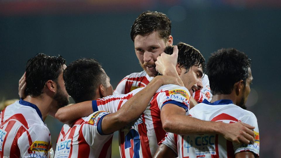 Atletico de Kolkata defender Henrique Fonseca Sereno (C) celebrates after he scores a goal against Kerala Blasters FC during the final Indian Super League (ISL) final.