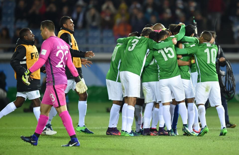 Atletico Nacional footballers celebrate their win over Club America following their penalty kick shootout at the Club World Cup.