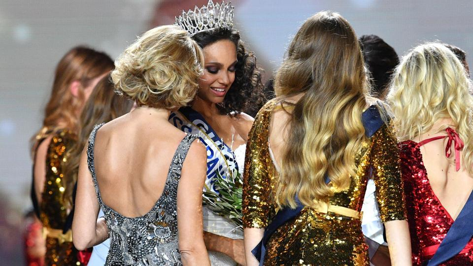 Newly elected Miss France 2017 Alicia Aylies (second from left) being congratulated by Miss France Society President and Miss France 2002 Sylvie Tellier (left) and the contestants after winning the title.  (AFP)