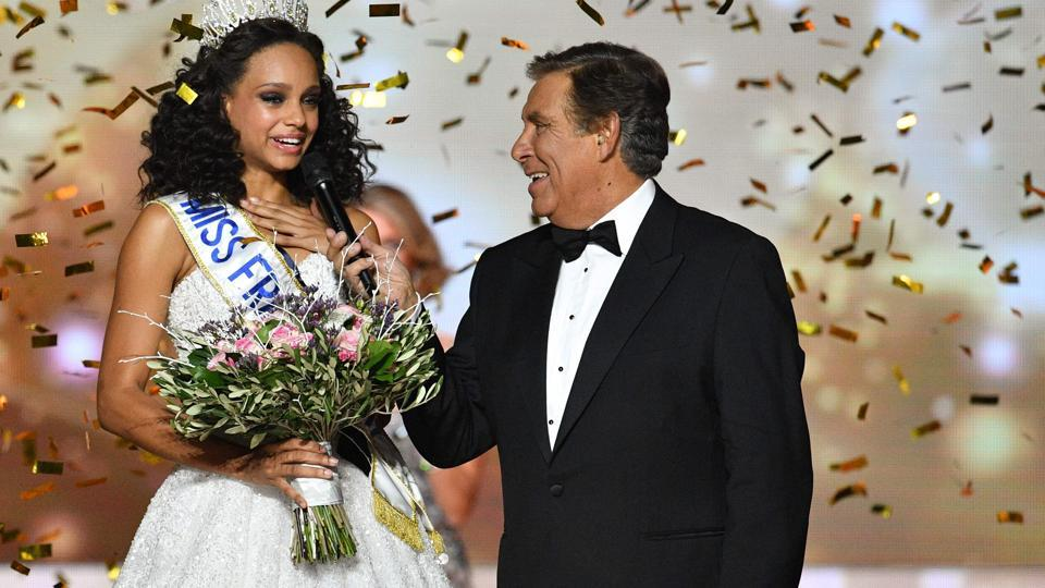 Aylies (left) with French TV host Jean-Pierre Foucault after she was crowned Miss France.  (AFP)