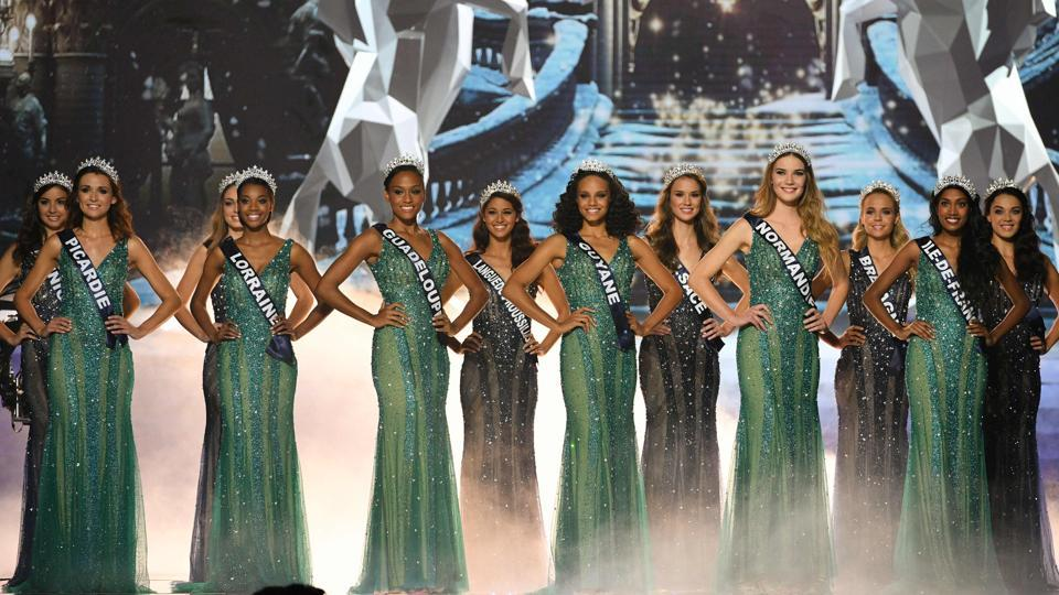 Contestants pose on stage during the competition.  (AFP)