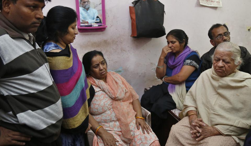 Veena Rani (third from left) lost her husband Satish Kumar when he died after waiting for six hours in a bank queue on November 21.