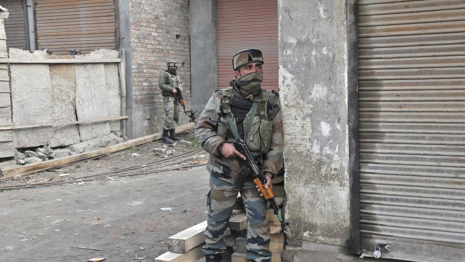 Soldiers conduct a search operation after a militant attack on an army convoy at Kadalbal Pampore on the Jammu-Srinagar National Highway on Saturday.