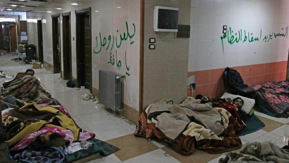 Injured and sick people wait inside a hospital to be evacuated from a rebel-held sector of eastern Aleppo, Syria. (Abdalrhman Ismail/Reuters Photo)