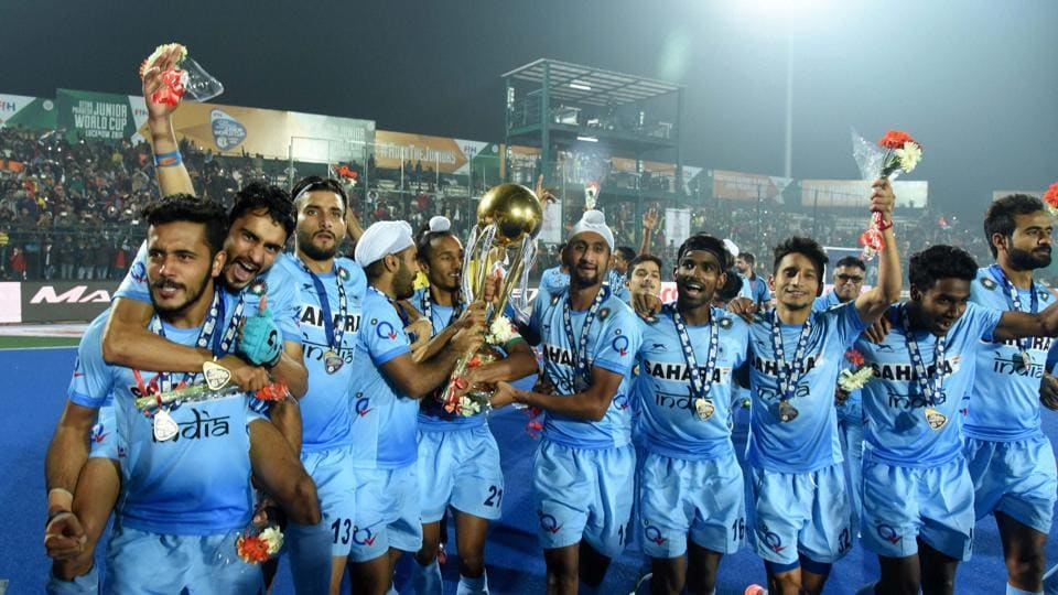 Indian Junior hockey players celebrate with the winning trophy after their victory over Belgium in the final of Junior World Cup Hockey 2016 in Lucknow.