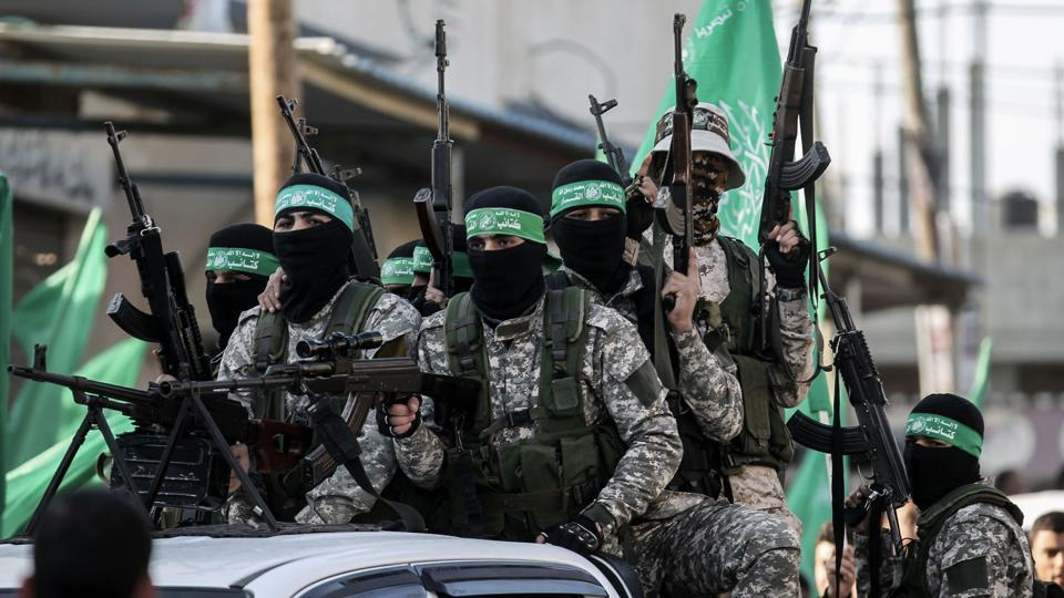 Members of the Ezzedine al-Qassam Brigades, the military wing of the Palestinian Islamist movement Hamas, take part in a rally marking the 29th anniversary of the creation of the movement on December 16, 2016, in Rafah in the southern Gaza Strip.