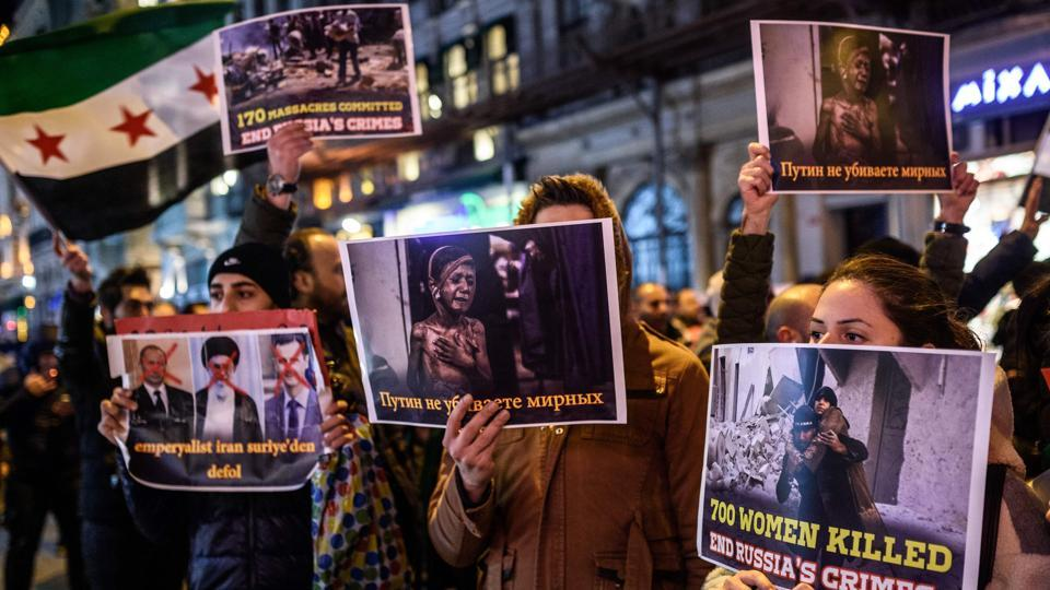 Syrians living in Turkey hold signs during a protest against Russia, Syrian president Bashar al-Assad's regime ally, in front of the Russian Embassy along Istiklal Avenue in Istanbul. (Ozan Kose/AFP Photo)