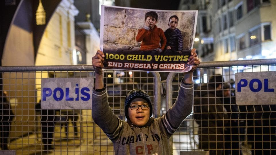 A Syrian boy living in Turkey holds a sign during a protest against Russia, Syrian president Bashar al-Assad's regime ally, in front of the Russian Embassy along Istiklal Avenue in Istanbul. (Ozan Kose/AFP Photo)