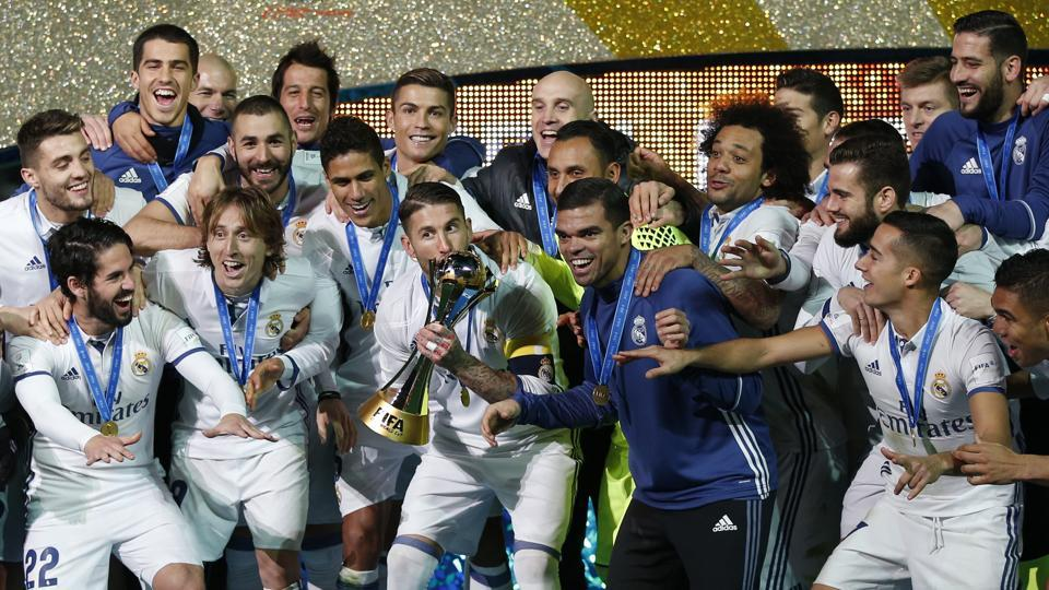 Real Madrid's Sergio Ramos and team mates celebrate winning the FIFA Club World Cup Final with the trophy.