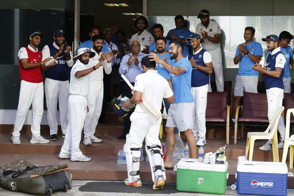 Karun Nair is congratulated by his teammates after his triple century against England in Chennai.