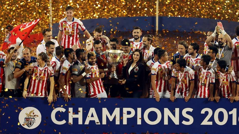 Atletico de Kolkata players celebrate with the Indian Super League trophy after beating Kerala Blasters in the final.