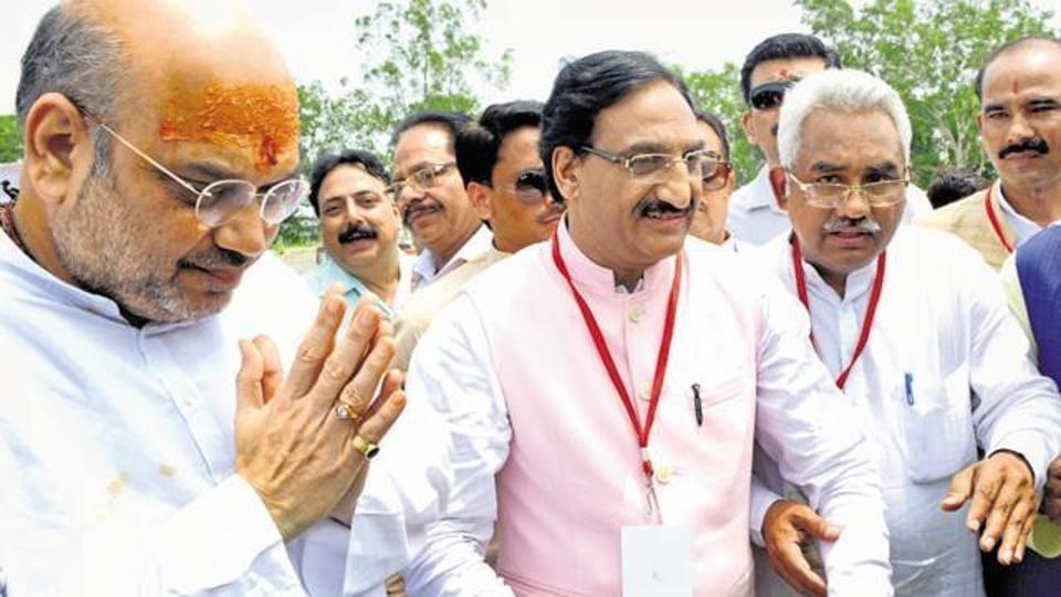 BJP president Amit Shah being welcomed by party MP Ramesh Pokhriyal Nishank (C) and MLA Madan Kaushik (R) in Haridwar on Jun 26, this year.
