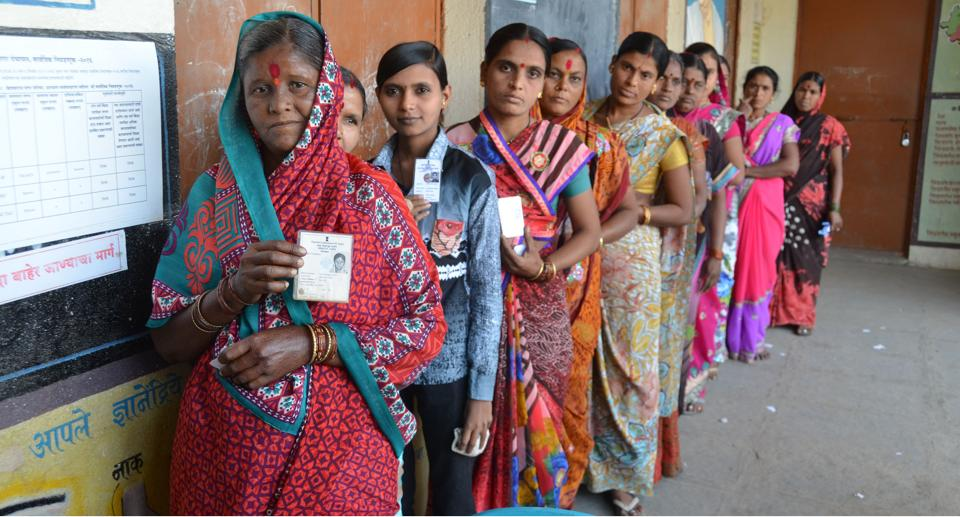 Voters stand outside a polling booth in Aurngabad on Sunday.