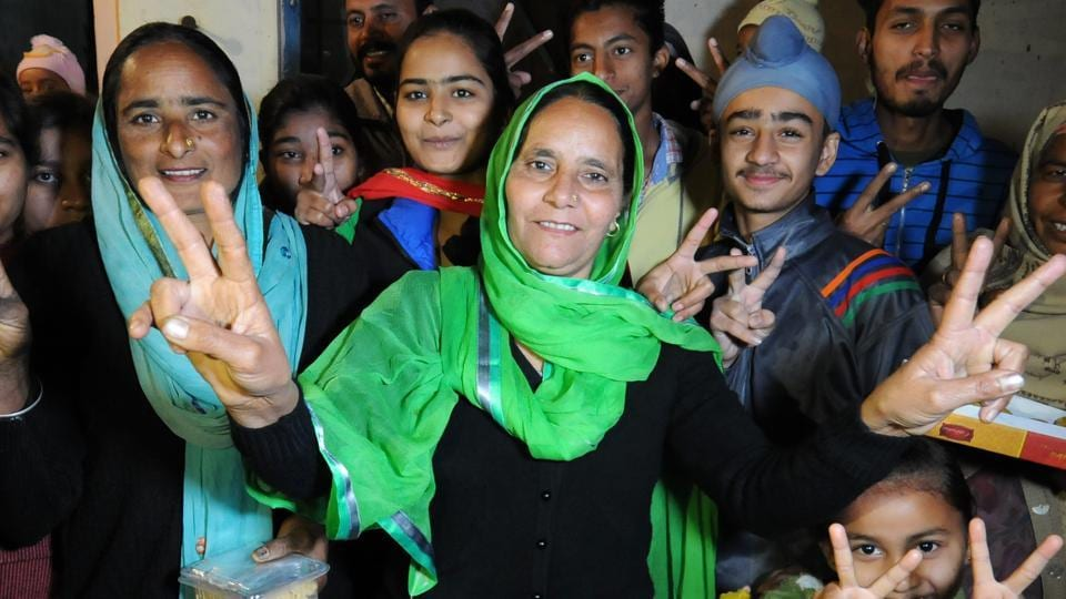 Harjeet's mother Balwinder Kaur (centre) with other family members in a celebratory mood. The family now awaits the return of its son.