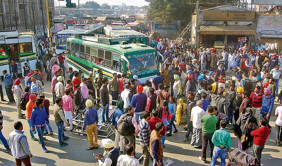 Suwidha Kendra employees and DC office employees protesting at the bus stand.