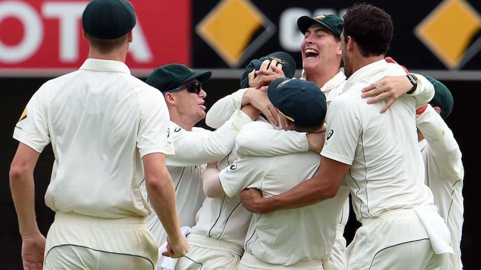 Australian players celebrate their victory over Pakistan in the first day-night cricket Test match between Australia and Pakistan in Brisbane on Monday.