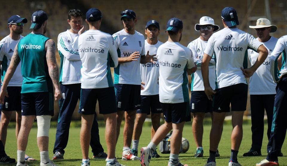 England cricket captain Alastair Cook (C) speaks with team members during a training session.
