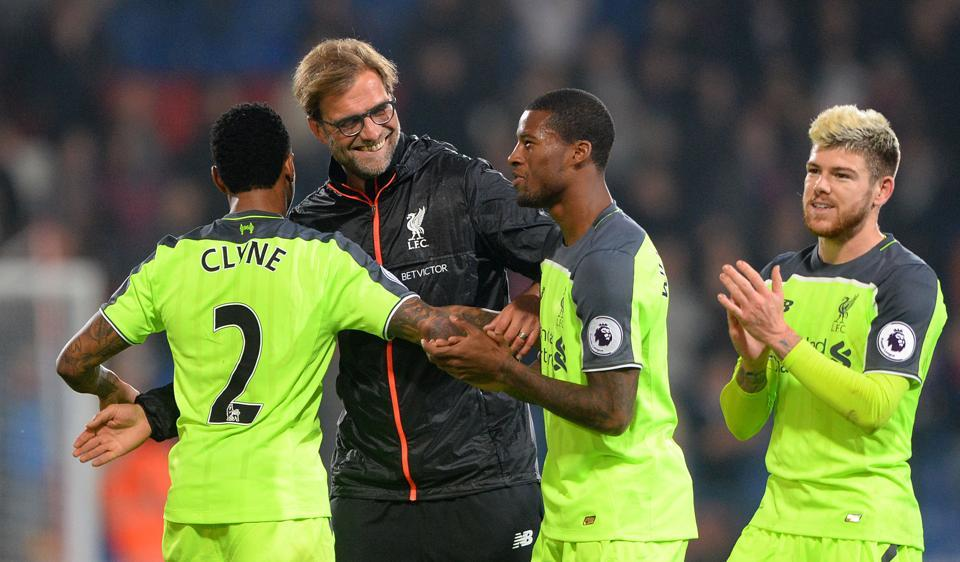 Liverpool manager Jurgen Klopp, 2nd left, celebrates with team members after their Premier League match against Crystal Palace.
