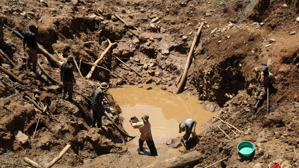 This file photo taken on May 15, 2008 shows a team of miners working in an open pit gold mine in Mongwalu, north eastern Democratic Republic of Congo. At least 20 people were killed in a gold mine collapse in the Democratic Republic of Congo, a local minister said on December 18, 2016.