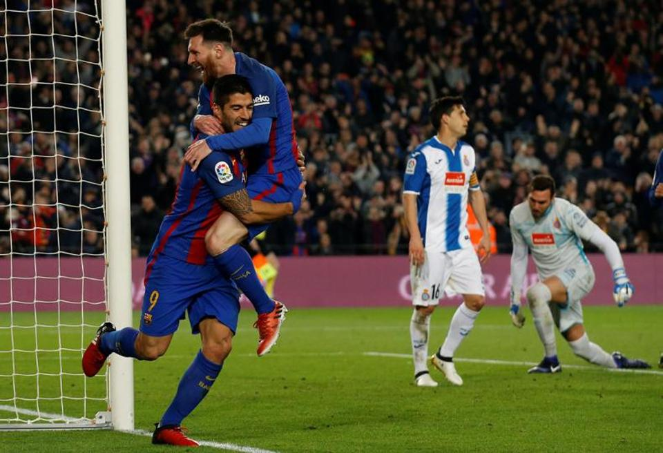 Barcelona's Lionel Messi weaved his way through five Espanyol defenders before his shot was saved and Luis Suarez swept home.