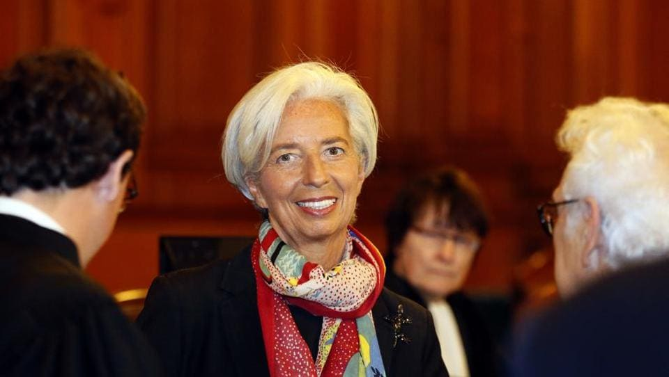 In this December 12 file picture, International Monetary Fund chief Christine Lagarde smiles as she arrives at the special Paris court, France.