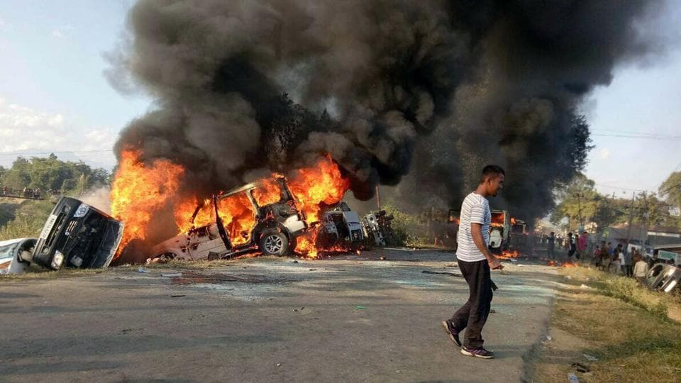 Vehicles are seen burning after being set alight by protesters in Imphal, the capital of India's northeastern state of Manipur.