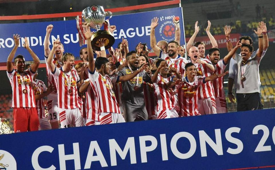 Atletico de Kolkata players celebrate after beating Kerala Blasters in to win the Indian Super League at the Jawaharlal Nehru Stadium in Kochi on Sunday.  (PTI)