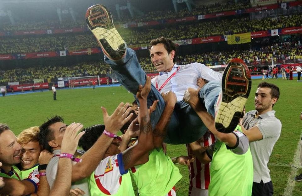 Atletico de Kolkata players celebrated by hoisting coach Jose Molina, who later called for a longer ISL season. (Vipin Pawar / ISL / SPORTZPICS)