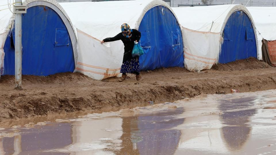 Heavy rain flooded  the Khazer camp on Monday. As winter creeps in, the days at the camp are getting chilly.  (Ammar Awad / REUTERS)