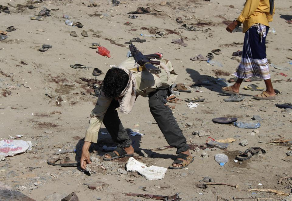 Yemen was a black spot for journalists with five killed. A soldier inspects the site of a suicide bomber at a base in the southern city of Aden, Yemen.