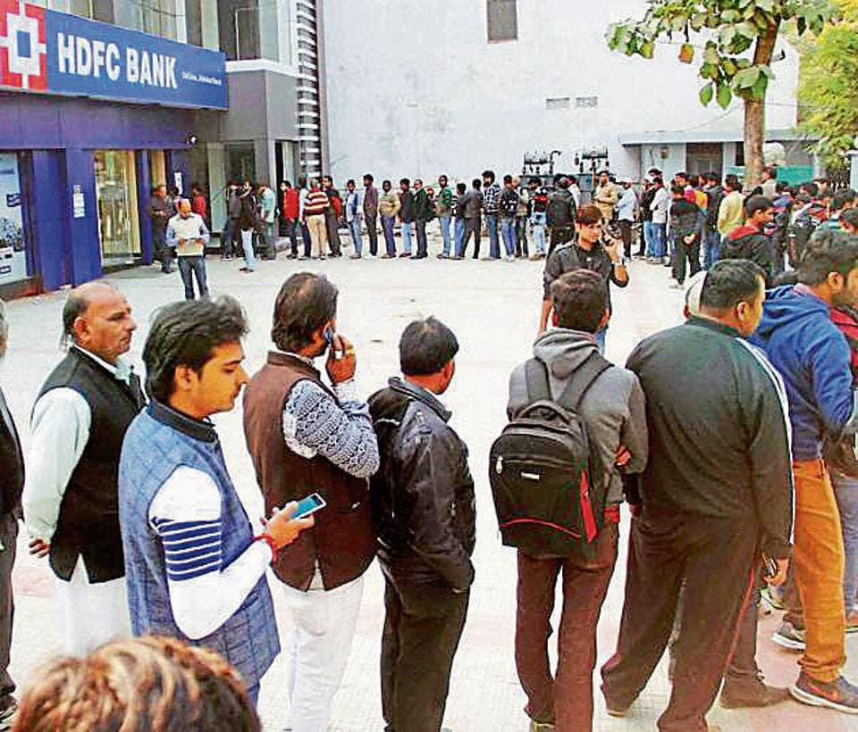 People stand in a long queue to withdraw currency notes at ATM. Most ATMs have been dispensing only 2,000 rupee notes.