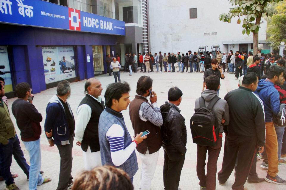 People stand in a long queue to withdraw money from an ATM in Allahabad. PMNarendra Modi's demonetisation move triggered a nationwide cash crunch.