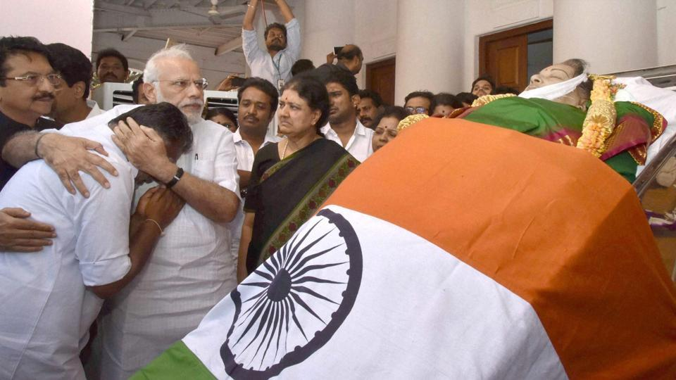 Prime Minister Narendra Modi consoles O Panneerselvam while pays his last respects to Tamil Nadu's former Chief Minister Jayaram Jayalalithaa, while Sasikala Natarajan looks on, Rajaji Hall, Chennai, December 6