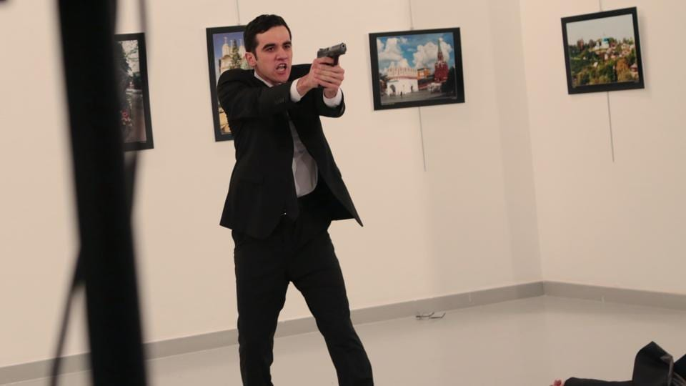 An unnamed gunman gestures after shooting the Russian Ambassador to Turkey, Andrei Karlov, at a photo gallery in Ankar.