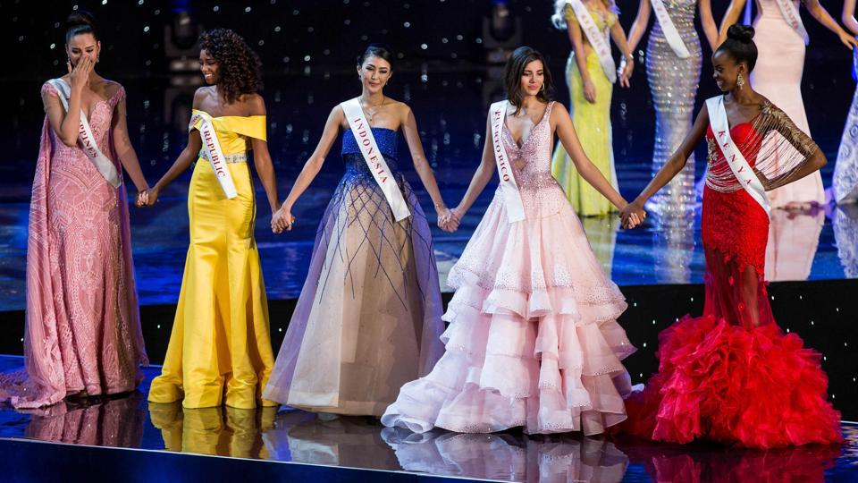 (L-R): Finalists Miss Philippines Catriona Elisa Gray, Miss Dominican Republic Yaritza Miguelina Reyes Ramirez, Miss Indonesia Natasha Mannuela, Miss Puerto Rico Stephanie Del Valle, and Miss Kenya Evelyn Njambi Thungu wait for the results of the pageant. (Zach Gibson/AFP)