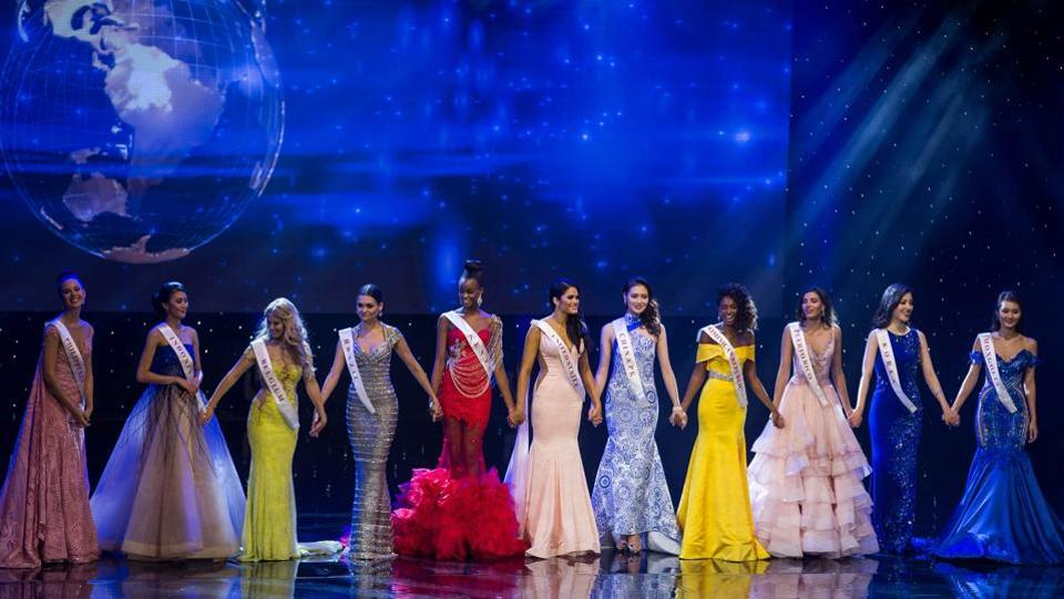 The top contestants hold hands before the pageant winner is announced during the grand final of the Miss World 2016 pageant at the MGM National Harbor. (Zach Gibson/AFP)
