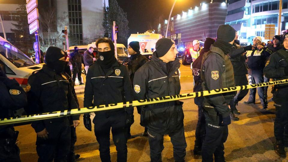 Turkish policemen stand guard near the Cagdas Sanatlar Merkezi, a major art exhibition hall, where Andrey Karlov, the Russian ambassador to Ankara, was shot dead.