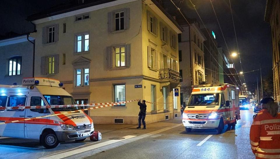 Ambulance and police cars are seen outside a Muslim prayer hall in central Zurich.
