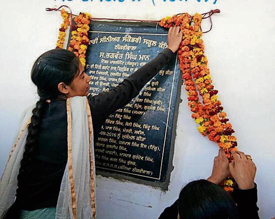 Students inaugurating the school building at Thikriwal village in Barnala on Tuesday.