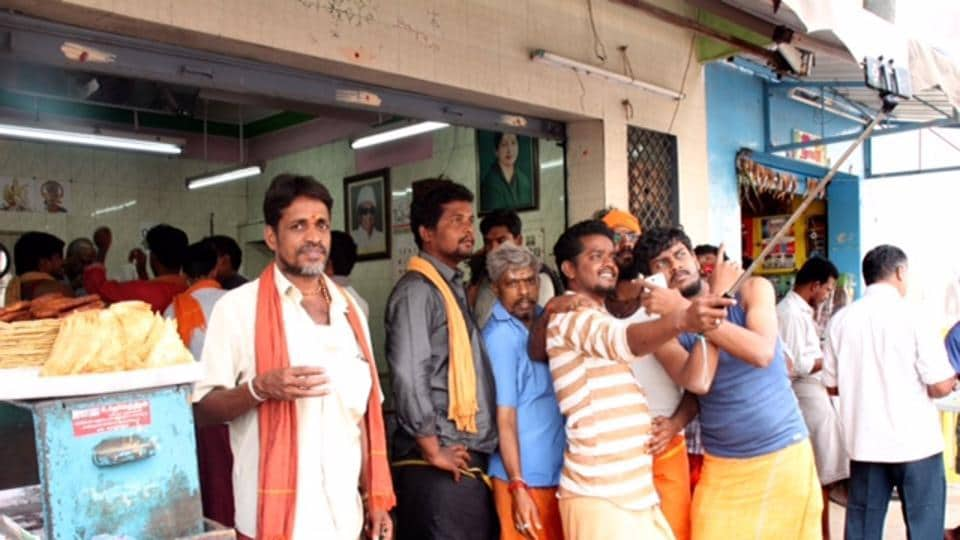 Customers take selfies at the OPS canteen. Ever since O Panneerselvam took over as Tamil Nadu's chief minister following J Jayalalithaa's death earlier this month, busloads of pilgrims have been stopping by a the stall in the town of Periyakulam.