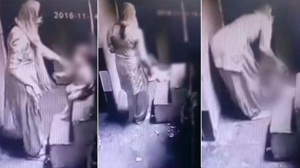 A screen grab from a security camera's video shows a woman assaulting a child.