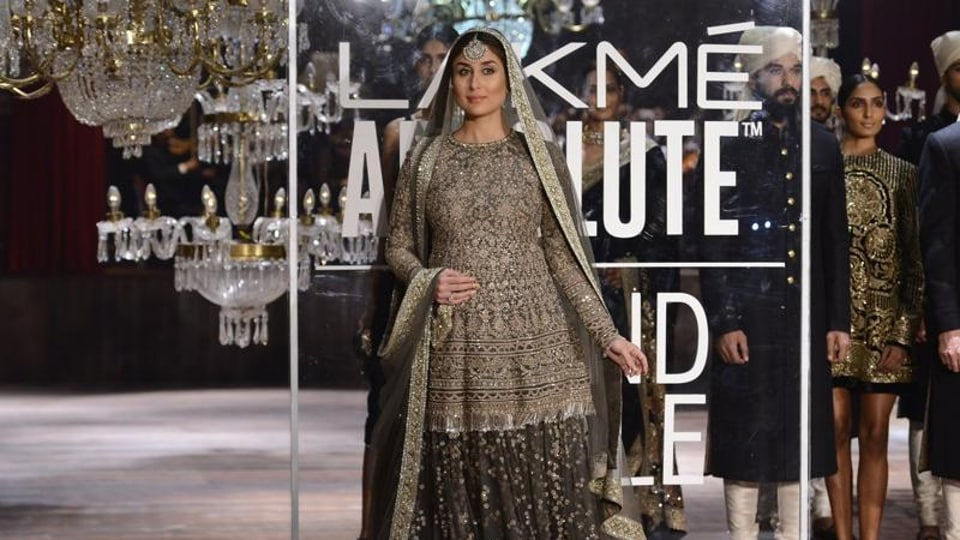 Dressed in a heavily embroidered olive-green lehenga and a kurti patterned choli with dupatta on her head, Kareena looks royal in this photo from her ramp walk at the Lakme Fashion Week.