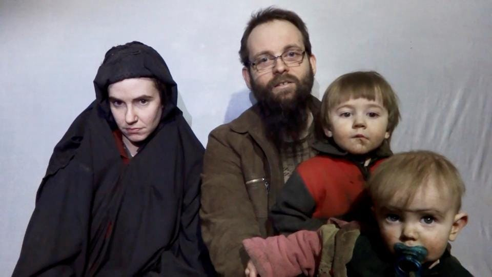 A still image from a video posted by the Taliban on social media on December 19, 2016 shows American Caitlan Coleman (left) speaking next to her Canadian husband Joshua Boyle and their two sons.