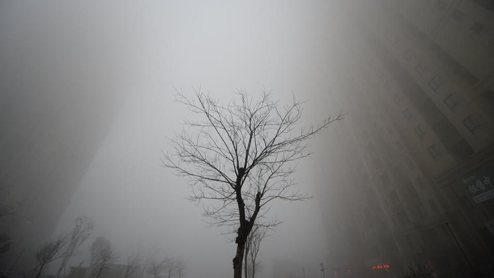 Buildings disappear behind heavy smog during a polluted day in Jinan, Shandong province, China. (Reuters photo)