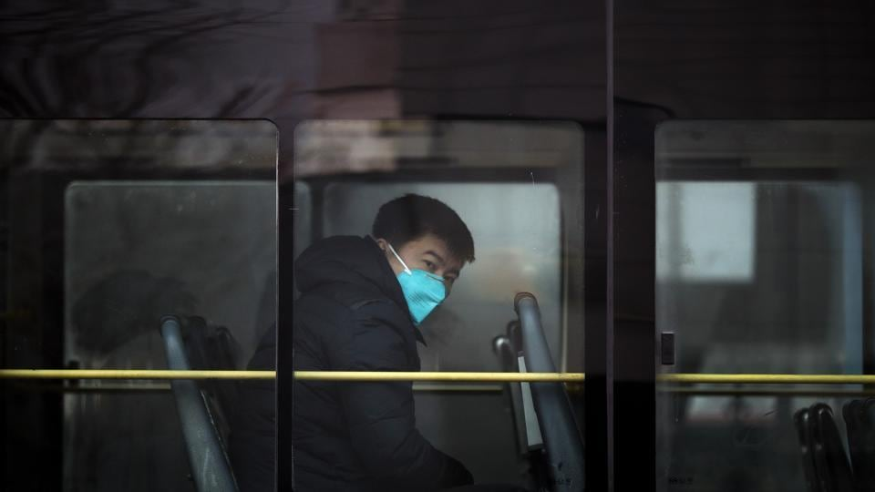 A man travels in a bus wearing a mask in Beijing. China's long-standing air pollution is blamed on its reliance on coal and emissions from older cars. (AP photo)