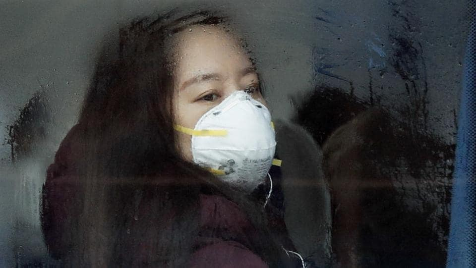 A woman wears a mask for protection in Beijing. (AP photo)