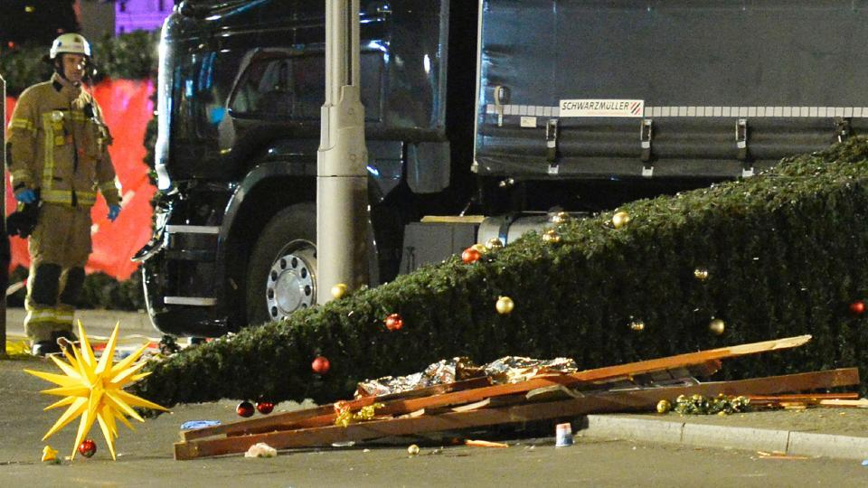 A Christmas tree lies on the ground after a truck rammed into a market at Gedächniskirche church in Berlin, killing at least 12 and wounding over 50 people, on December 19. (AFP Photo)